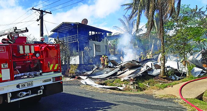 Firefighters at the scene. The fire at Kavika Place in Nakasi that destroyed two homes.  Photo: Shalveen Chand