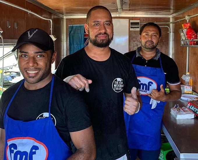 Taking a break from the movie industry, professional chefs Sanaila Tuivaua, Jarrel Kamea and Ricky Vollmer inside Fiji's first food truck. Photo:The Fiji Food Truck