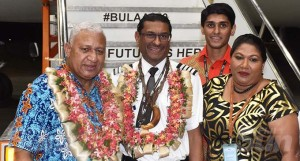Prime Minister Voreqe Bainimarama with Fiji Airways Captain Satpreet Singh, wife Sharmila Singh, son Prashant Preet Singh (standing at back) at the Fiji Airways Hangar, Naisoso, Nadi. Photo: Waisea Nasokia