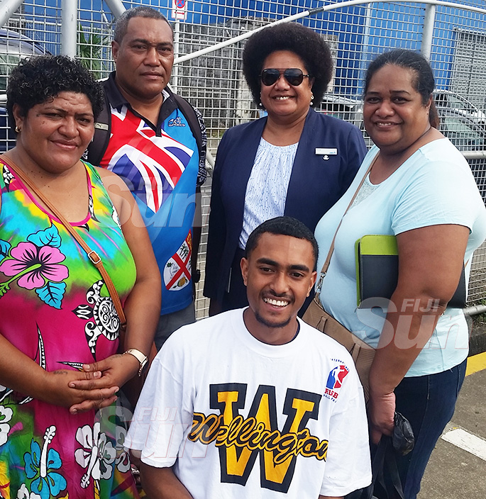 Soko Vakacegu (standing right) with relatives at Narain Jetty waiting for her trip on Princess Moana to Ogea, Lau. Photo: Maika Bolatiki.