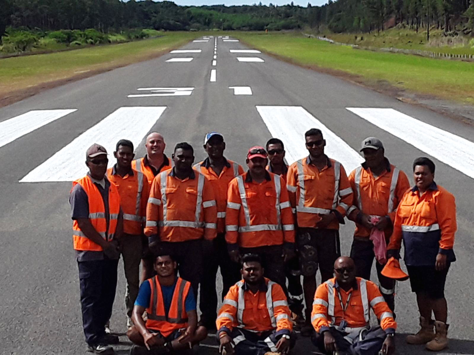 Staff after completing the runway upgrade in Lakeba.