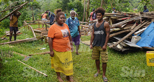 Wairua Settlement residents, Bale Fane 25, Viliame Koroi 69 and Josua Vere 27 watch helplessly as their home been dismantled and they were evicted by land owners, The SDA church in Tamavua on December 11, 2019. Photo: Ronald Kumar. Photo: Ronald Kumar.