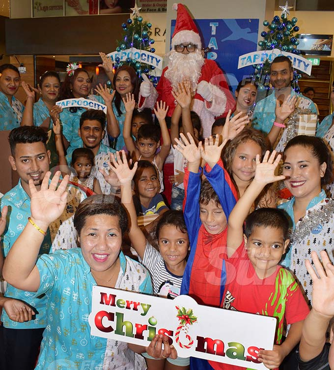 Many of children who visited the TappooCity complex in Suva had an opportunity to have a photo taken with Santa Claus. Photo: Ronald Kumar