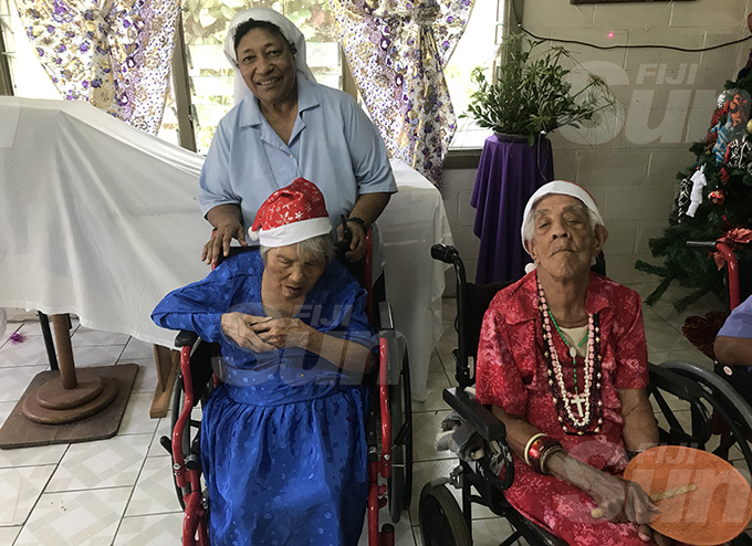 Sister Elena Lauwai (standing) with Mary Fong (left sitting) and resident of the Father Law Home at Wailekutu, Lami on December 12, 2019.