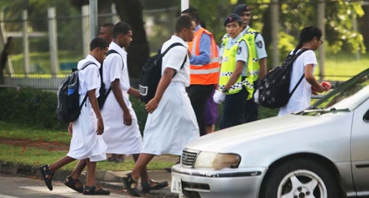 Police Assist Students Cross Roads As New Academic Year Begins