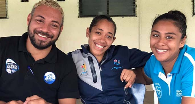 Astral Smith (right) with staff of the Fiji Hockey.