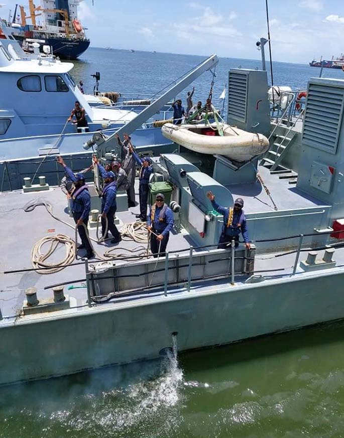 Crew of the RFNS Kula wave goodbye to family members as they set sail for Australia.