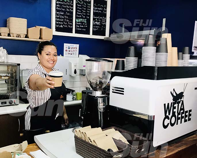 Barista Irene Hiagi serves a drink at Weta Coffee. Photo: Frederica Elbourne