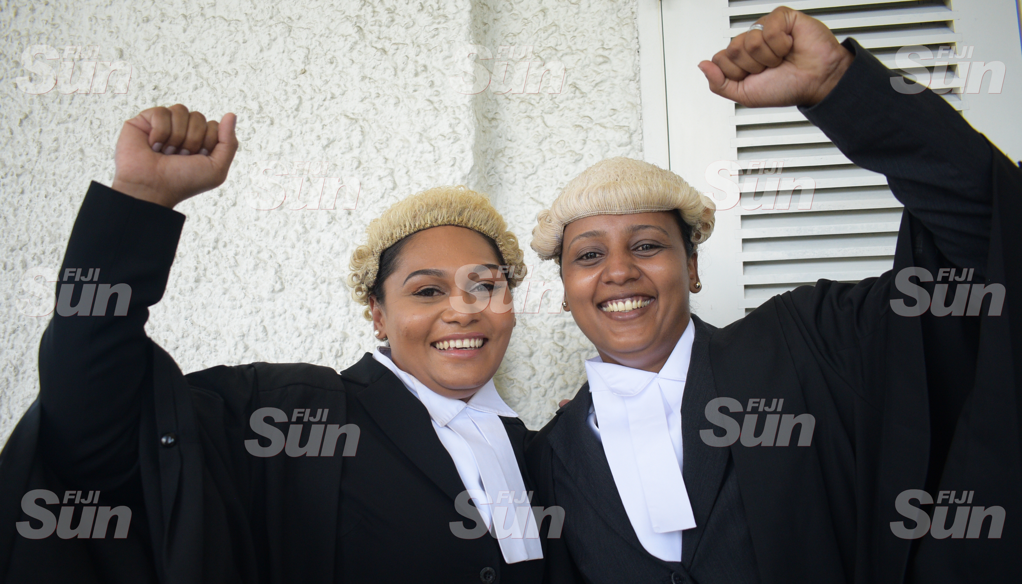 School mates, Estein Thaggard (left) and Nichole Prasad celebrate after their admission to the Bar on January 31, 2020. Photo: Ronald Kumar.
