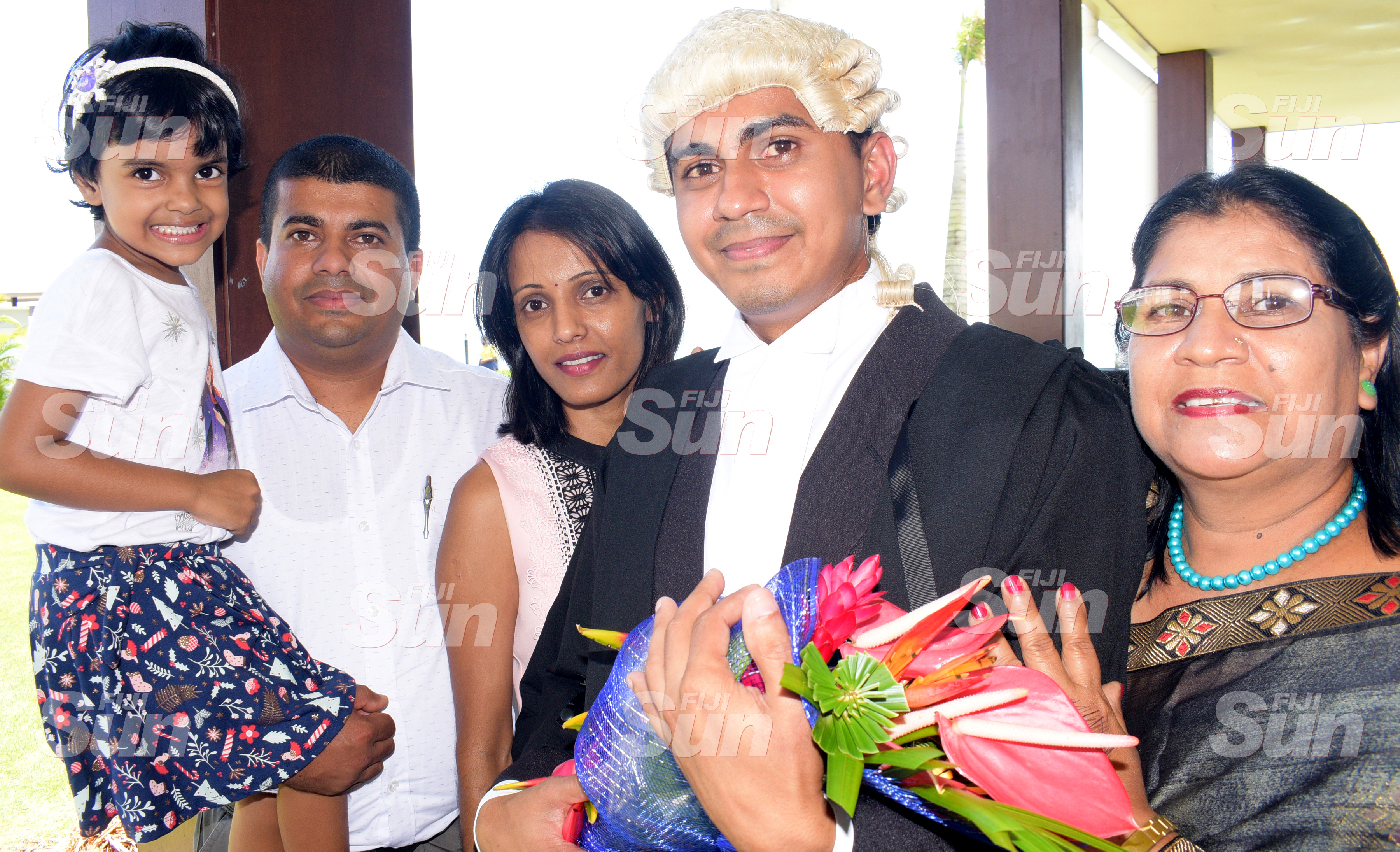 Prashant Susuhil (second from right) celebrate with his family members after his admission to the Bar on January 31, 2020. Photo: Ronald Kumar.