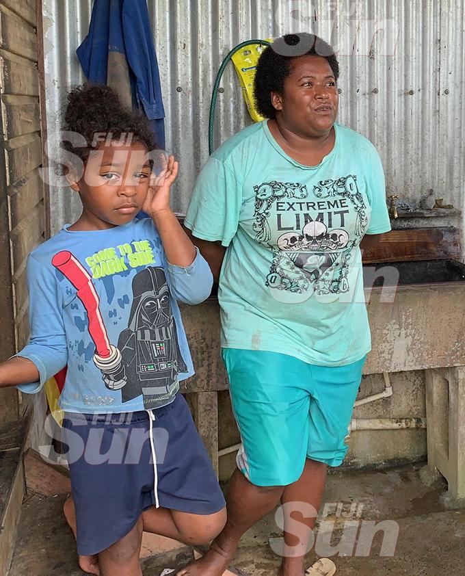 Napolioni Kaitavo (Junior) left with school teacher Rosalia Kaitavo at their house at Nuku Secondary School on January 17, 2020. Photo: Fernando Lobendahn