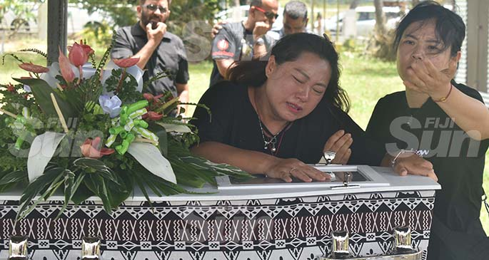 Fiance Jin Ling weeps during the funeral of Hua 'Jerry' Tao at the Nadovi cemetery outside Nadi town yesterday. Photo: Waisea Nasokia