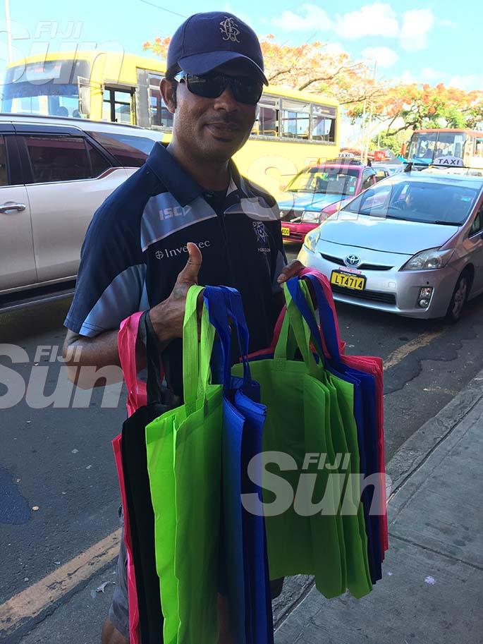 Peniasi Ravuna selling carry bags in Suva. Photo: Renu Radhika