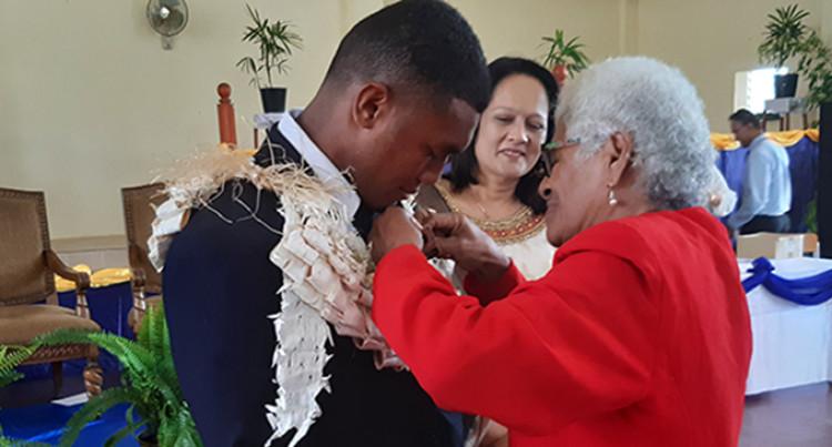 Elated Grandma Pins Ratu Kadavulevu School Head Boy's Badge On Mosese Qionimacawa
