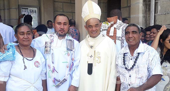Deacon Sinapati Ioane (second from left) and Archbishop Peter Loy Chong (third from left), with family members at the Sacred Heart Cathedral in Suva on February 22, 2020. Photo: Inoke Rabonu
