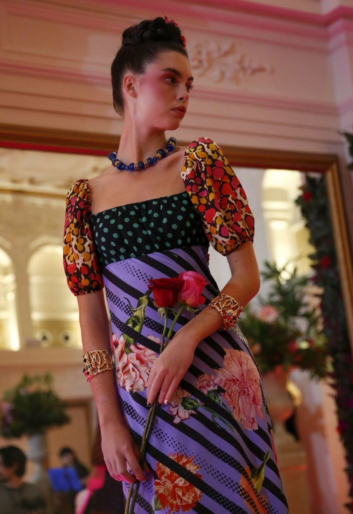 A model is seen on stage during the RIXO presentation at the London Fashion Week at Kimpton Fitzroy London Hotel in London, Britain. (Xinhua/Han Yan)