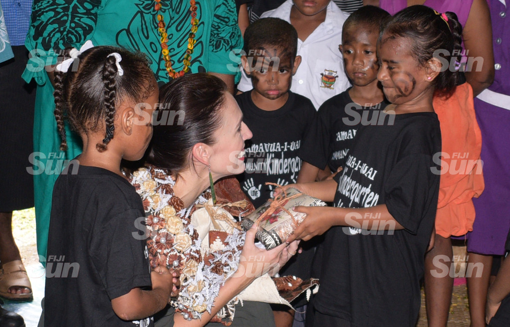 New Zealand Prime Minister Jacinda Ardern received sarong (sulu) from Raijeli Keni of Tamavua-i-wai Kindergarten during her visit to the Village on February 26, 2020. Photo: Ronald Kumar.