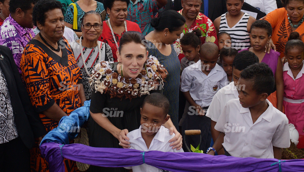 New Zealand Prime Minister Jacinda Ardern with 8 year-old Matai Baba and Tamavua-iwai Villagers during her visit to the village on February 26, 2020. Photo: Ronald Kumar.