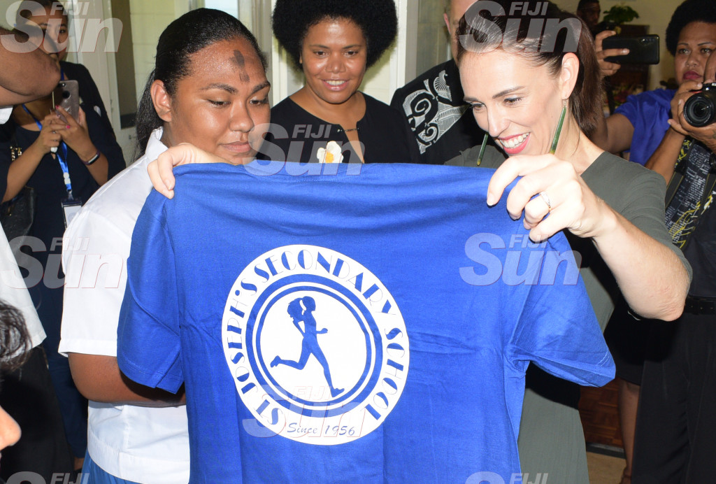 Visiting New Zealand Prime Minister Jacinda Ardern received St. Joseph Secondary t-shirt from year 11 student, of St. Joseph Secondary School Ann Mary Raduva during Women leaders launch function a New Zealand High Commissioners residence on February 26, 2020. Photo: Ronald Kumar.