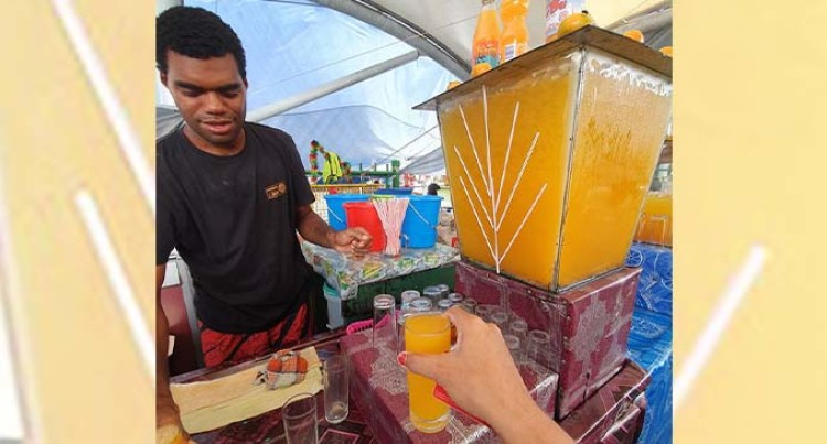 Smiling Masilaca Draws Many To Buy Juice