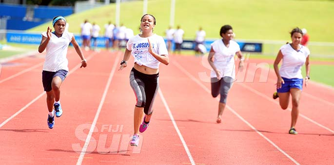 Jada Varatamana (second from left) won the junior-girls 100meters heats during St Joseph Secondary School trails at ANZ Stadium on February 8, 2020. Photo: Ronald Kumar.