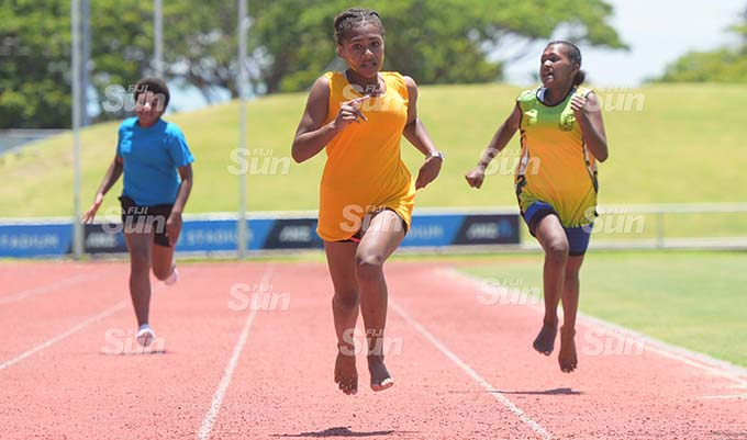 Josavini Dikobau (middle) during Suva Sangam junior-girls  heats at ANZ Stadium on February 19, 2020. Photo: Ronald Kumar.
