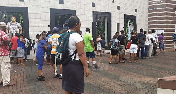 People lining up outside the Fiji National Provident Fund branch in Suva on March 30, 2020. Photo: Shreeya Verma