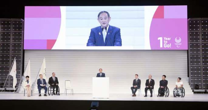 """Japan's Chief Cabinet Secretary Yoshihide Suga gives a speech during the """"One Year to Go"""" ceremony held to celebrate the one year countdown to Tokyo 2020 Paralympic Games in Tokyo, Japan, Aug. 25, 2019. (Xinhua/Du Xiaoyi)"""