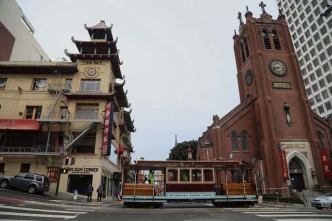 An empty tourist trolley is seen in San Francisco, the United States, March 16, 2020. (Photo by Liu Yilin/Xinhua)