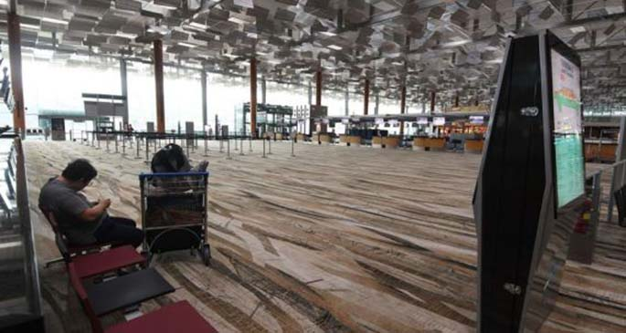 Photo taken on March 19, 2020 shows an almost empty departure hall at the Singapore Changi Airport in Singapore. (Photo by Then Chih Wey/Xinhua)