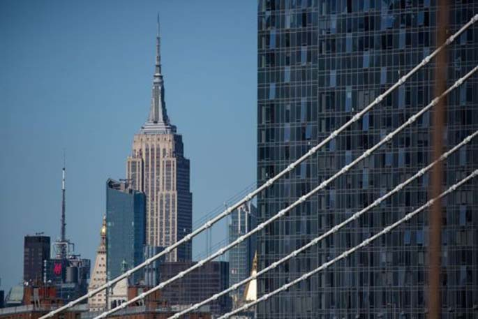 The Empire State building is seen from the Brooklyn Bridge in New York, the United States, on March 27, 2020. (Photo by Michael Nagle/Xinhua)
