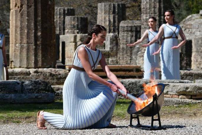 Greek actress Xanthi Georgiou, playing the role of an ancient Greek High Priestess, lighting the torch of the Olympic Flame during the flame lighting ceremony for Tokyo 2020 Olympic Games in Olympia, Greece on March 12, 2020. (Photo by Antonis Nikolopoulos/Xinhua)