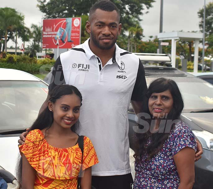Fiji Airways 7s rep Sevuloni Mocenacagi is flanked by fans Pooja Chand (left) and Kamrul Nisha (right) at the Nadi International Airport on March 11, 2020.  Photo: Waisea Nasokia