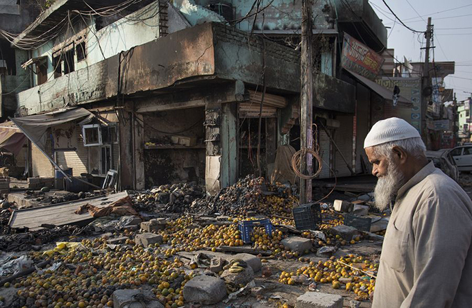 A man walks through a vandalized market after violence-ravaged New Delhi, India, Feb. 26, 2020. (Xinhua/Javed Dar)