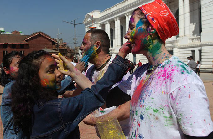 People put colour powder to each other in the celebration of Holi Festival in Kathmandu, capital of Nepal, March 9, 2020. (Xinhua/Sunil Sharma)