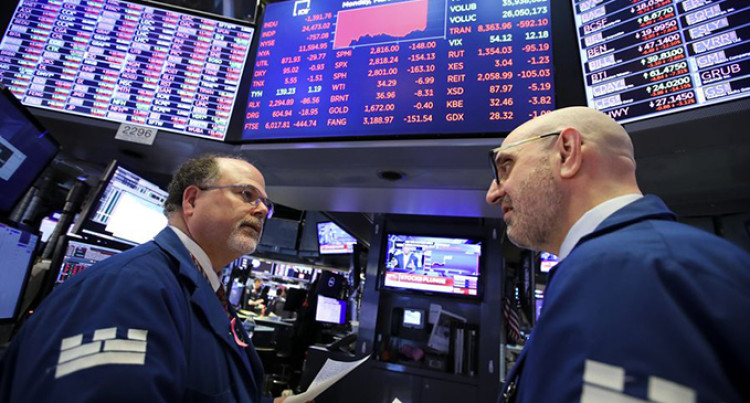 The Latest: Dow Closes Down Over 2,000 Points, Oil Prices Plunge