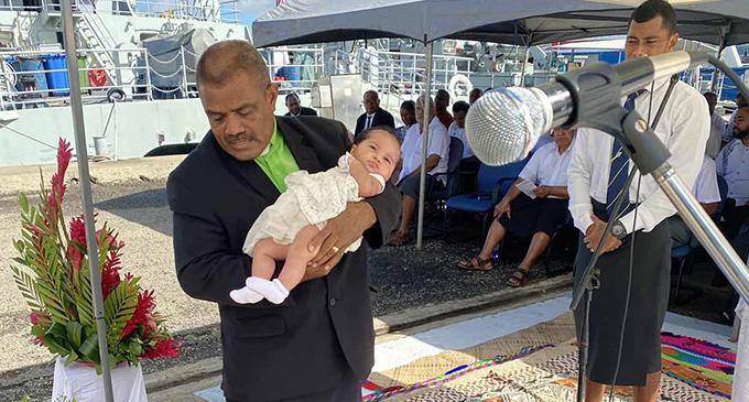 RFMF chaplain Reverend Ilaitia Sevati Tuwere carries baby Meri Bainitakali Sereana Halepuleyaga during her baptism at the Stanley Brown Navy Base in Walu Bay.