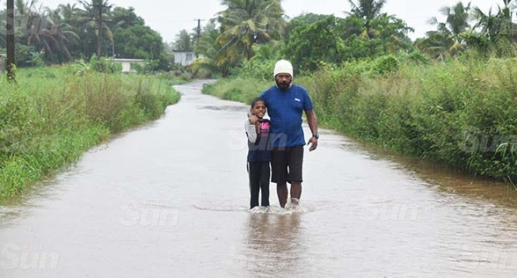 Weather: West Residents Wade Through Flood Waters