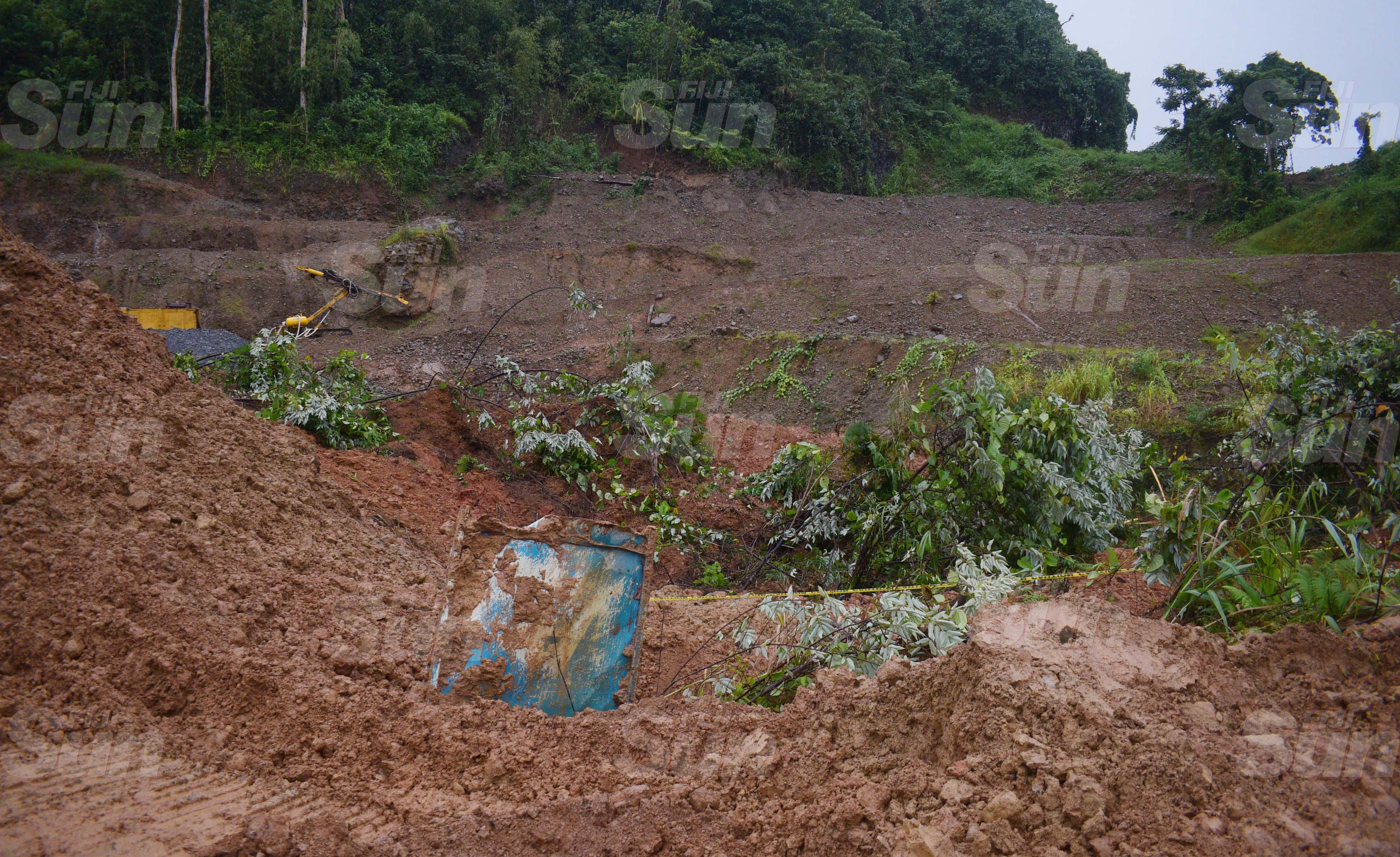 The body of the third person is believed to be buried within this area of landslide. The search will only recommence as the weather improves. Photo: Ronald Kumar.