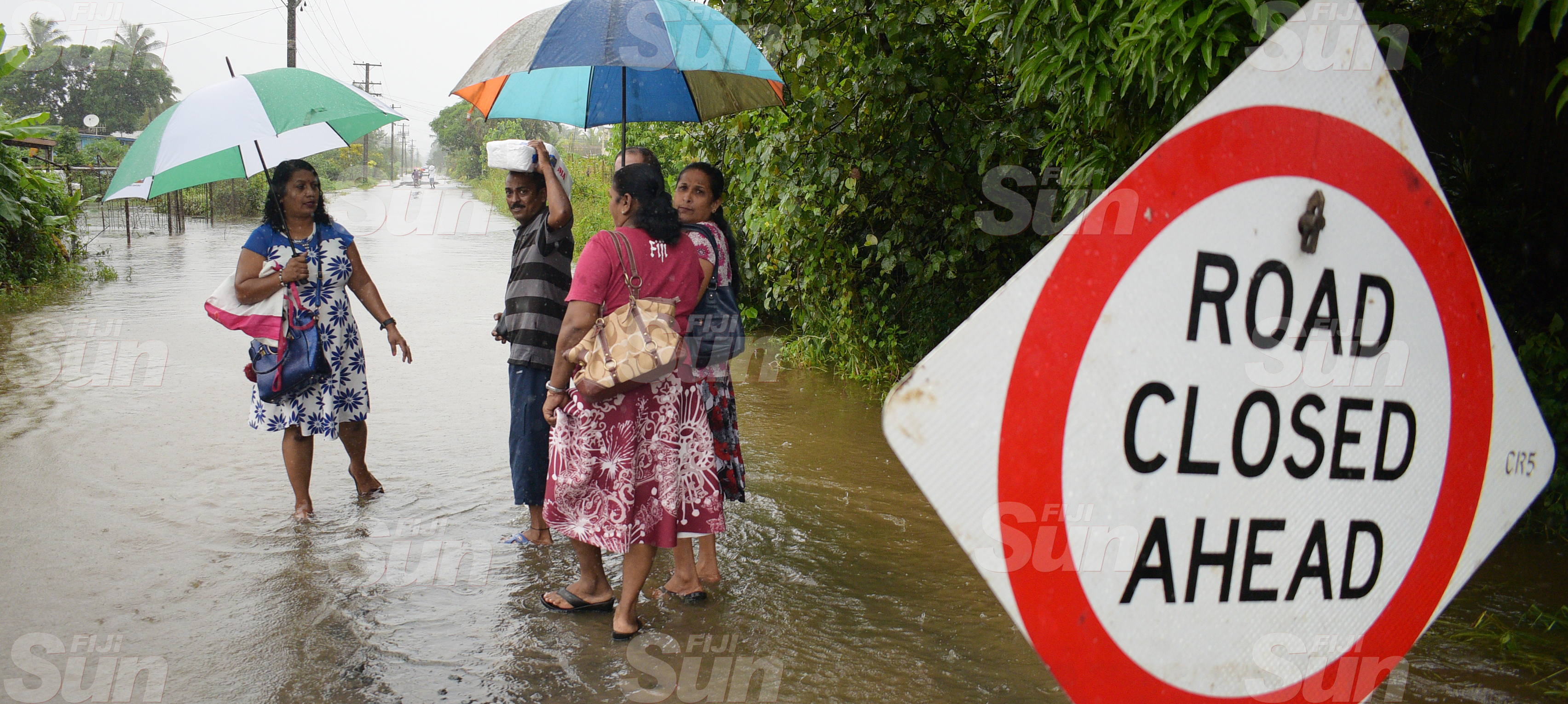 Naduru Road residents of Nausori had to walk through the flooded road as their road was closed dur to flooding on March 20, 2020. Photo: Ronald Kumar.