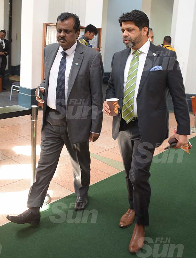Minister for Sports Praveen Bala and Attorney General and Minister for Economy Aiyaz Sayed-Khaiyum outside Parliament on March 27, 2020. Photo: Ronald Kumar.