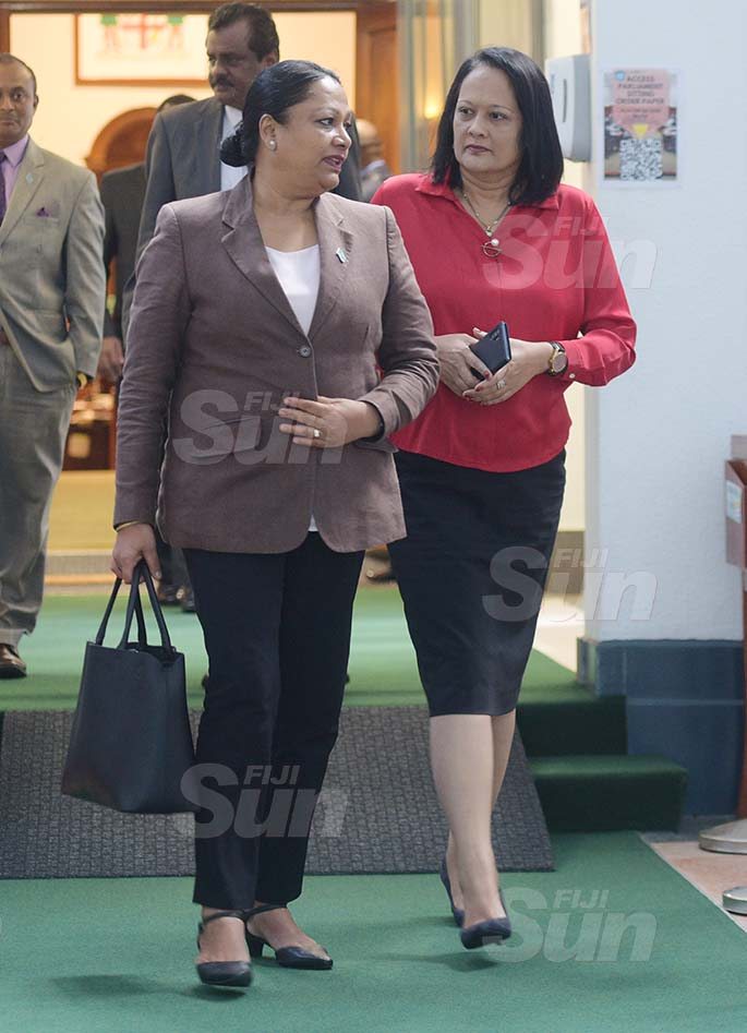 Minister for Trade and Tourism Premila Kumar and Education Minister Rosy Akbar outside Parliament on March 27, 2020. Photo: Ronald Kumar.