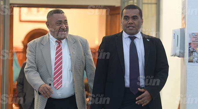 Opposition Member of Parliament Ratu Suliano Matanitabua (left) and Assistant Minister for Youth and Sports Alipate Naqata outside Parliament on March 27, 2020. Photo: Ronald Kumar.