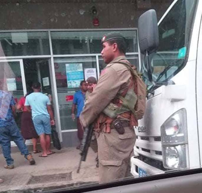 A Republic of the Fiji Military Forces soldier stands guard outside the Fiji National Provident Fund Lautoka branch on March 30, 2020.
