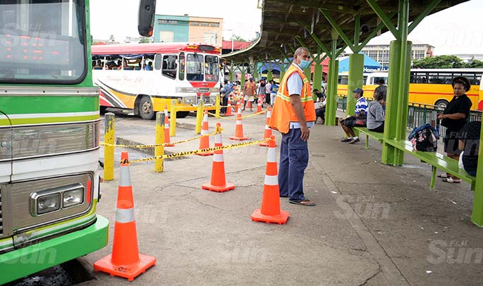 Suva City Council enforcement officer Isosefo Matanawa monitors people's movement at Suva bus stand as cone been placed at the bus stand for people to practice social distancing on March 31, 2020. Photo: Ronald Kumar.