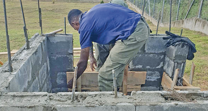 A Republic of Fiji Military Forces engineer at work in the building of the incinerator at the Navua Hospital.