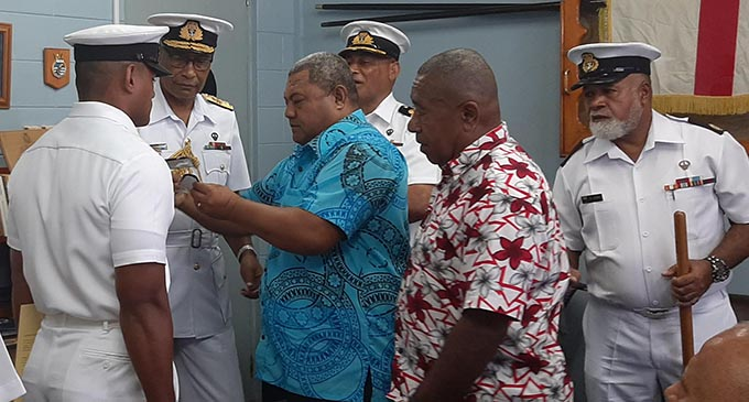 RFMF Commander Rear Admiral Viliame Naupoto, second left gave  Taraiasi Vuetanasau (uncle), and Solomone Tuinasau (step father) the honour to commission Ensign Sitiveni Sokotiviti. Photo: Shreeya Verma