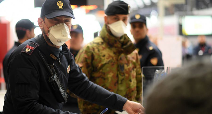 A policeman with a face mask is on duty at Milan Central Railway Station in Milan, Italy, on March 9, 2020. (Photo by Daniele Mascolo/Xinhua)