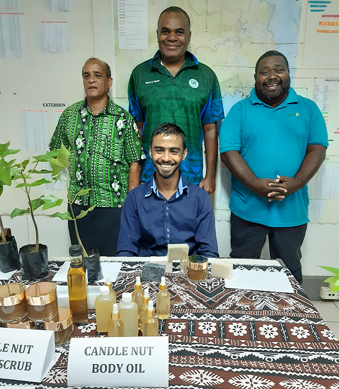 Averyl Avchial (seated), standing from left: Averyl's dad Abhay Chaudhry with Ministry of Forestry's Director  Forest Operations Central Eastern George Vuki and Forest Officer Korovou Ilaitia Seroma flank the young  entrepreneur. Photo: Ministry of Forestry