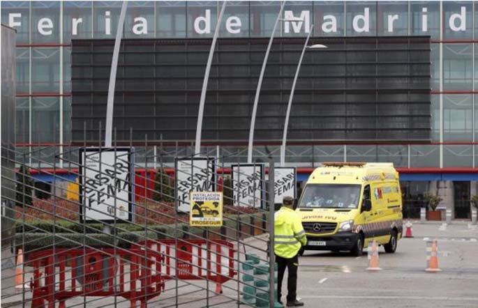 An ambulance arrives at the IFEMA Exhibition center in Madrid, Spain, March 23, 2020. LATIN AMERICA OUT. (EFE/Handout via Xinhua)